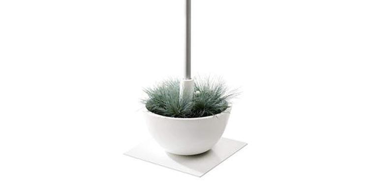 coupe parasolvoet met planten erin