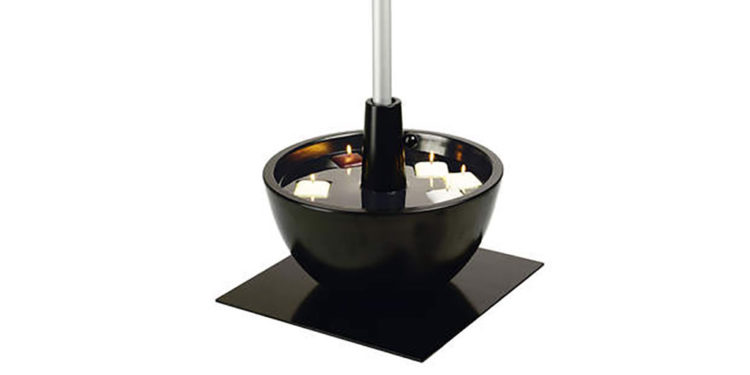 coupe parasol base, filled with water and floating candles