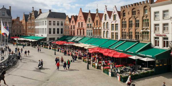 Quattro parasols on the market square of Bruges